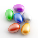 varicoloured painted eggs on a white background