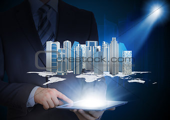 Man in suit holding tablet pc and skyscrapers