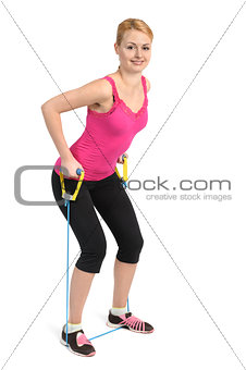 Back and arms exercise using rubber resistance band