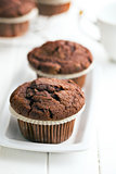 chocolate muffins on white table