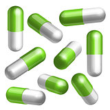 Set of green and white medical capsules in different positions