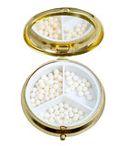 compact pill box with mirror and homeopathy balls