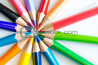 Close up detail of colorful pencils arranged in circle