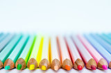 Close up detail of colorful pencils with white background