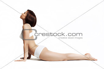 young beautiful yoga posing - upward facing dog