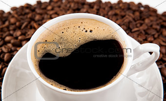 cup of black coffee with foam