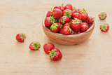 Close-Up Of Strawberries In Vintage Wooden Bowl On Table