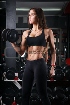 girl holding a dumbbell