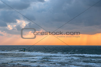 kitesurfing  and storm clouds over the sea