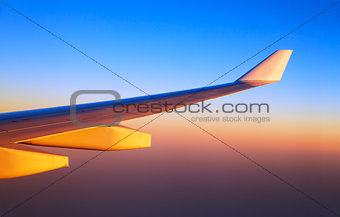 Airplane wings in sunset light