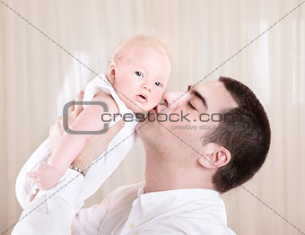 Handsome daddy kissing daughter