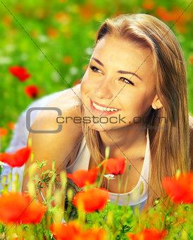 Beautiful female enjoying on the flower field
