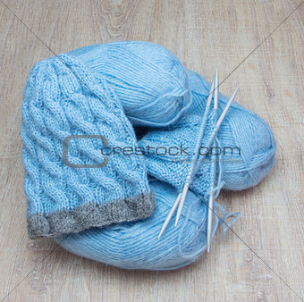 knitted cap and blue yarn
