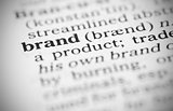 Macro image of dictionary definition of brand