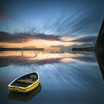 Single boat floating no water during sunrise over sea with light