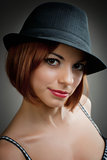 Model in black trilby style hat