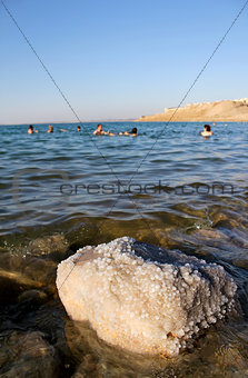 Dead Sea coastline, whit salt crystals and formations in the san