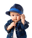 Cute baby boy holding hat
