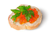 Red caviar on the bread and butter