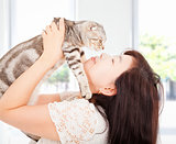 pretty woman hug and kiss her cat