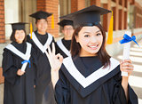 young college graduate holding diploma  and make a gesture