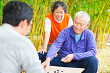 seniors play traditional chinese board game Go