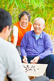 "male seniors win a chinese board game .""weiqi"""