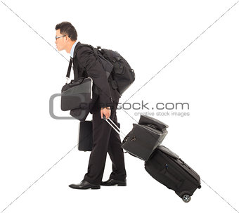 tired young businessman pulling and taking all belongings