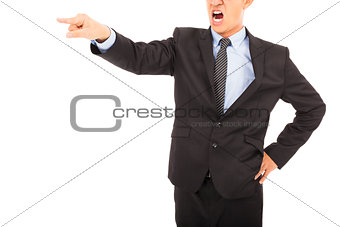 angry businessman pointing to  something with yelling