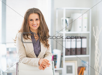 Portrait of happy business woman standing in office