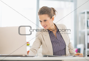 Business woman working with laptop in office