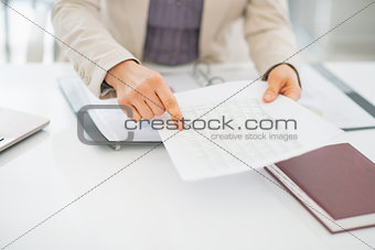 Closeup on business woman pointing on document