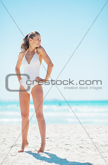Full length portrait of young woman looking on copy space