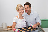 Young couple preparing cookies together in the kitchen