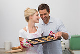 Couple preparing cookies together in kitchen