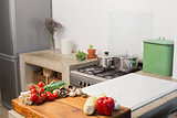 Raw vegetables on kitchen counter