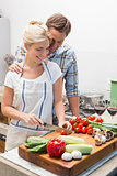 Couple preparing food together in the kitchen