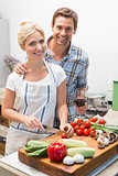 Young couple preparing food together in kitchen