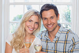 Close-up of a happy loving couple with wine glasses