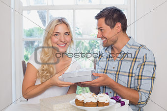 Beautiful young blonde receiving a gift box