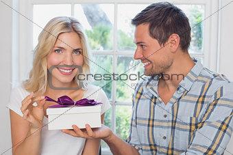 Beautiful young blonde receiving a gift box