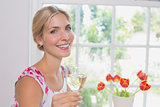 Portrait of a happy young woman with wine glass