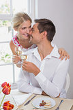 Happy couple with wine glasses having food