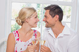 Loving couple with wine glasses looking at each other