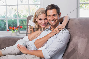 Portrait of relaxed loving couple sitting on sofa
