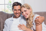Portrait of relaxed cheerful loving couple at home