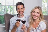 Young couple with wine glasses at home
