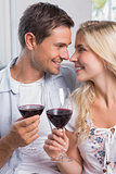 Loving young couple with wine glasses at home