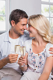 Loving couple with champagne flutes at home
