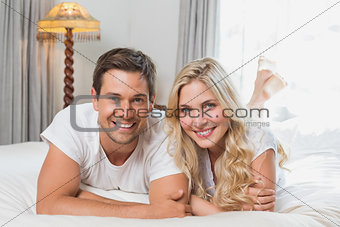 Portrait of a relaxed casual couple resting in bed